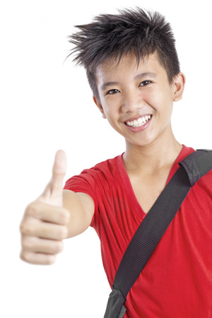 Happy young student in thumbs up. Isolated in white background.