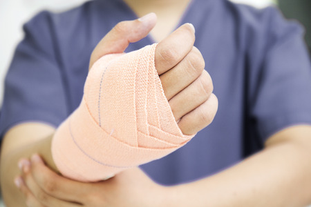 Close up of a hand with medical bandage.