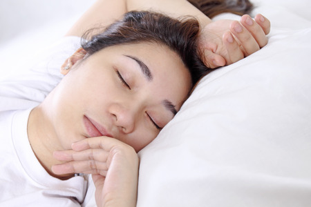 Close up of a young asian lady sleeping peacefully. photo