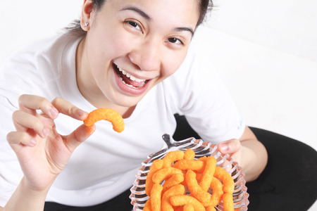 junk food: Happy lady eating junk foods. Stock Photo
