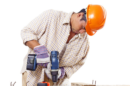 Busy construction worker using a drilling tool.Isolated in white background. photo