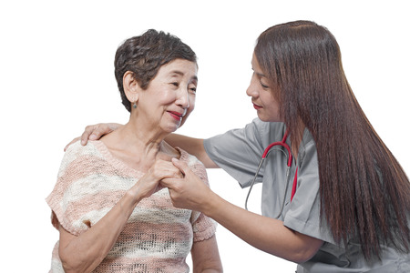 caring for: Doctor or nurse caring for an elderly patient. Isolated in white background.