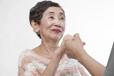 Close up of a helping hand to a senior woman. photo