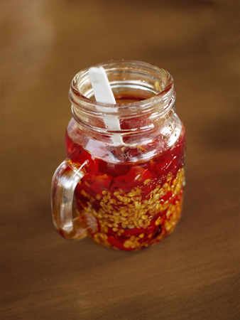 Red hot chili oil in a glass served in an asian restaurant.