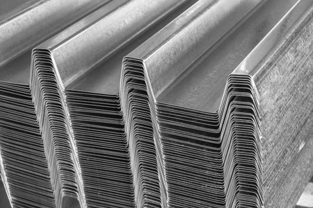 Galvanized steel corrugated roof profile stacked on a palette