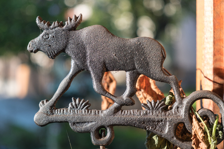 Vintage bronze moose ornament closeup Stock Photo