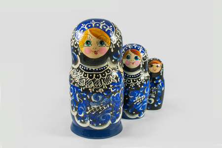 Traditional Russian hand painted Matryoshka dolls in various sizes, studio shot on a light gray background