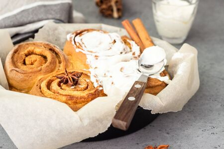 Cinnamon rolls (Cinnabon) baked in a cast iron skillet with cream cheese icing. Kanelbullens dag.