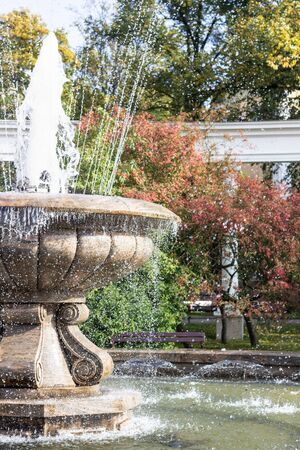 Round garden water fountain in the park. Outdoor romantic cities beautiful fountain background. Peaceful scenery with fountain.