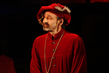A man dressed as Magnifico. A scene from the drama of the play by Shakespeare.