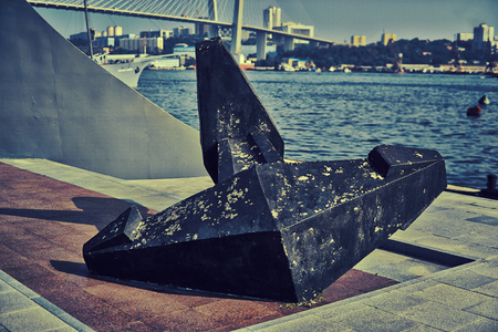 A ship anchor on the shore of the Bay near the monument to the discoveries