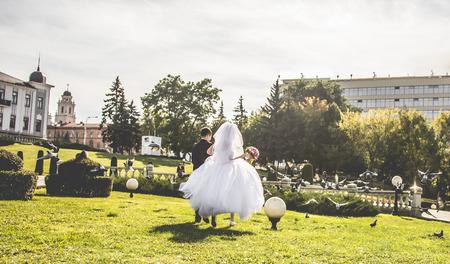 joyfull: Newlyweds running on the centre of Minsk
