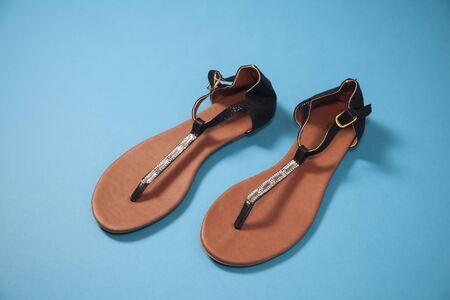 A pair of girl`s black flip flops Stock Photo