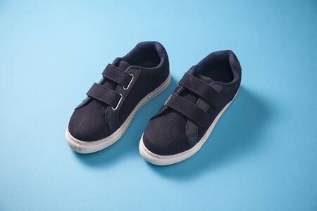 Gray cute pare of baby boy sneakers Stock Photo