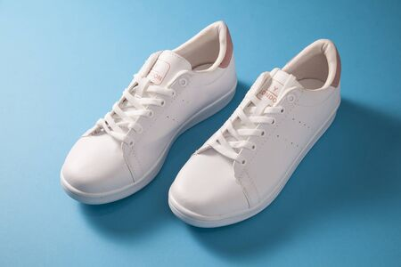 White pair of girl`s sport shoes