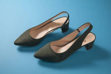 A pair of dark green kitten heels shoes Stock Photo