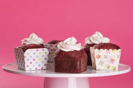 cup cakes in pink backgraound Stock Photo