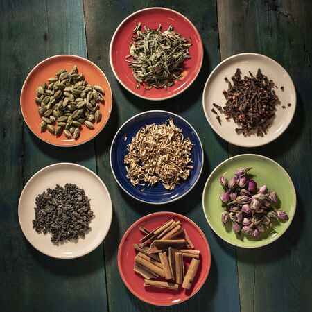 colorful kinds of fruits, flowers and herbs for tea
