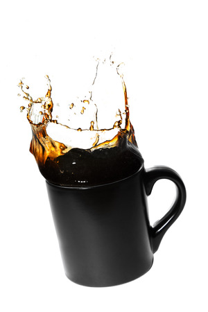 caffeinated: splashing coffee in a black cup Stock Photo