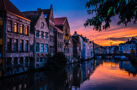 Beautiful Belgian town of Gent and its reflection in river Leie water Stock Photo