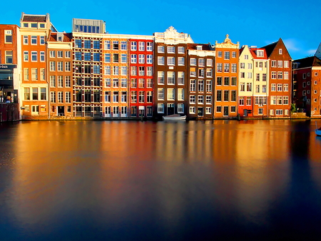 specific: beautiful view of the traditional old buildings of amsterdam on water level Stock Photo
