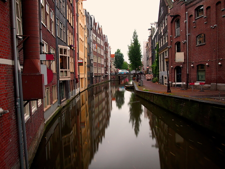Nice view of a canal in amsterdam which are reflected in historic buildings Stock Photo