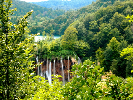 Beautiful waterfalls immersed in nature and surrounded by greenery in the Plitvice Lakes National Park Stock Photo