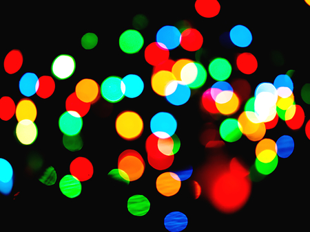 blurred christmas lights to create a harmonious colorful abstract background