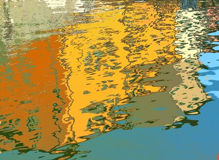 Colorful abstract background made using water as a mirror. Colored houses reflected in the calm water of a canal. 写真素材