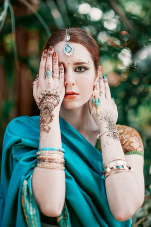 indian wedding: The european girl in the blue Indian costume.