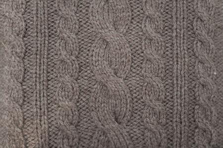 A handmade grey knitting wool texture background.