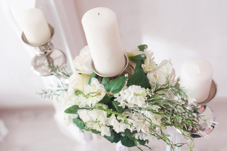 candlestick: Romantic wedding flower bouquet with silver candlestick.