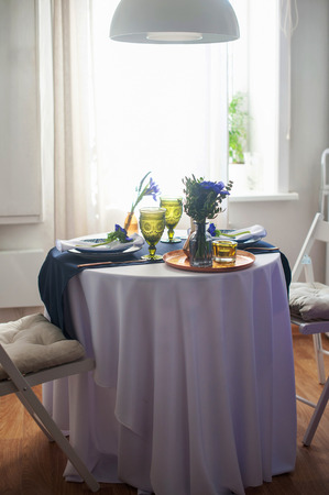anemones: Wedding table setting with blue anemones and iris. Stock Photo