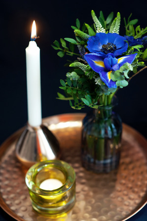receptions: Wedding table setting with blue anemones and iris. Stock Photo