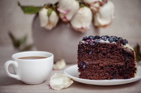 Chocolate cake with blueberry on a white plate