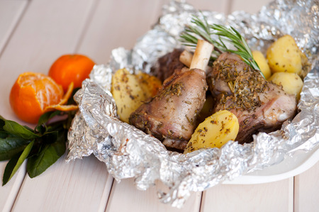 Lamb meat - roasted leg of lamb with rosemary, spices and roasted potatoes