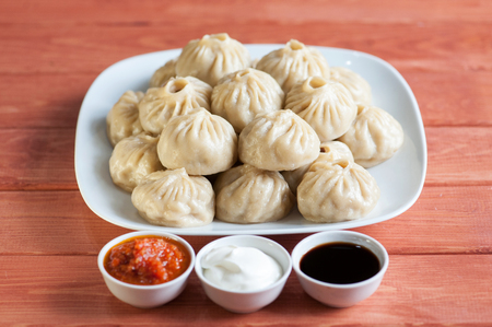 Buuza (poza) is a Buryat (Mongolian) national dish, paste packet.
