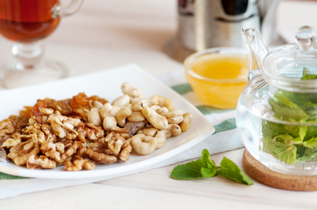 Healthy breakfast: nuts mix and mint tea.