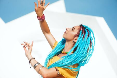 Beautiful colored girl dreads on the street.