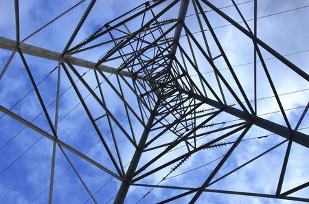 electricity pylon viewed from below with blue sky