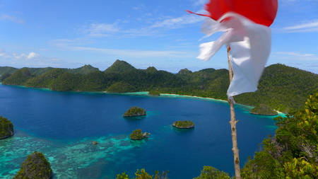 top View of the lagoon on Wayag archipelago with the Indonesian flag, Raja Ampat, west Papua, Indonesia