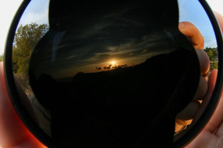 Sunset landscape reflected in the wide angle lens Stok Fotoğraf
