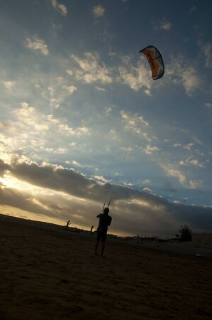 kite surfers and colorful sails on the beach of playa el médano in South Tenerife near punta del médano Banco de Imagens