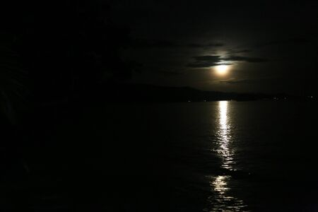 Red full moon sunset and reflection In Raja Ampat, West Papua, Indonesia
