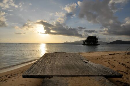 view of the wood jetty during the sunset in the Anse d'Argent beach, La Digue Island, Seychelles Stock Photo
