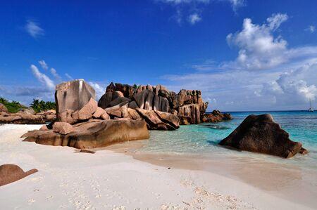 Idyllic beach with granitic rocks in Anse Cocos, La Digue island, Seychelles