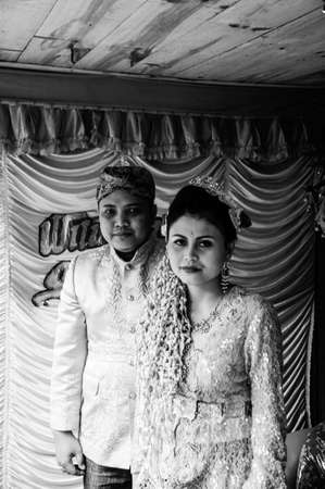 Mount Gede, West Java / Indonesia - June 17, 2010: typical traditional Indonesian Wedding, of the bride and groom portrait. Black and white