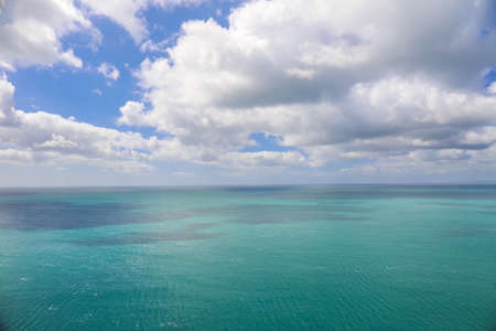 Ocean view with turquoise water and blue sky with clouds Stock Photo