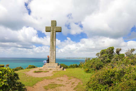 Large concrete crucifix or cross memorial at Dodman point between Gorran Haven and Boswinger in South Cornwall, England, UK