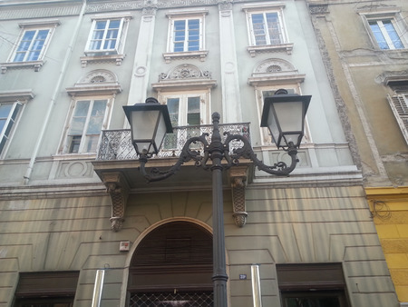 neoclassic: An example of historic lamppost in front of a neoclassic building in the centre of Trieste
